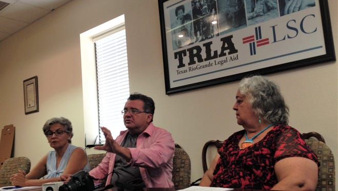 Attorney Carmen Rodriguez, from left, and historians David Romo and Yolanda Chavez Leyva, of the Paso Del Sur advocacy group, speak at a news conference Monday with Texas Rio Grande Legal Aid.