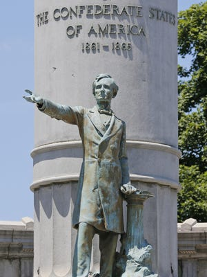 A statue of Confederate President Jefferson Davis stands on Monument Avenue in Richmond, Va. A city commission is considering whether to remove such statues.