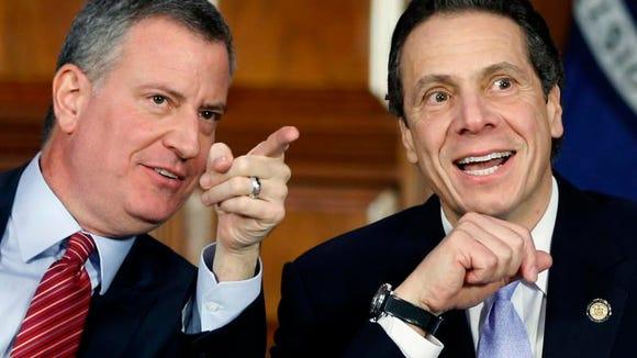 New York Mayor Bill de Blasio, left, and Gov. Andrew