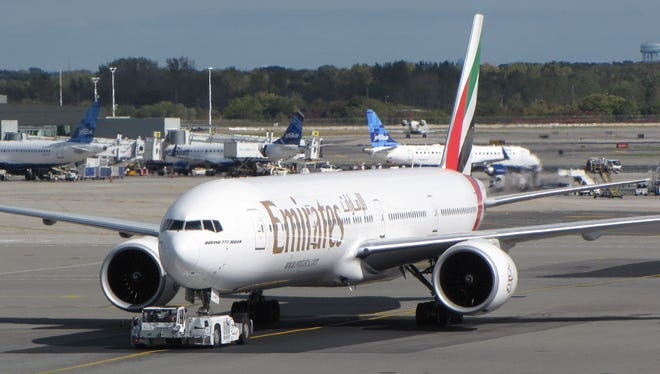 An Emirates airline Boeing 777 jet taxis toward the runway at New York's JFK International Airport on Oct. 18, 2012.
