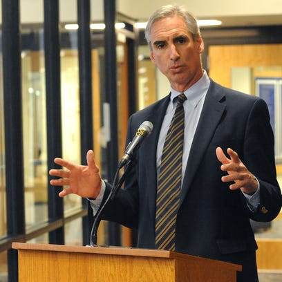 In this Dec. 16, 2010, file photo, West Virginia University athletic director Oliver Luck speaks addresses the media during a news conference in Morgantown, W.Va.