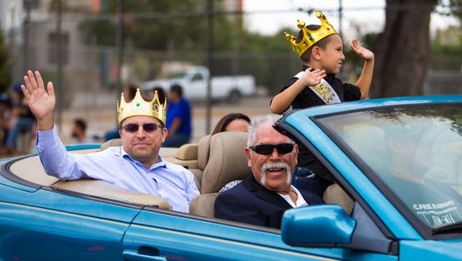 "Parade Grand Marshal Roberto Estrada with Braden Tidwell, the ""Onion King"" in the backseat as well as the CARE Prince, Matthew Jaramillo, 5, at the first The Big Event: A Community that CAREs parade on September 23, 2017."