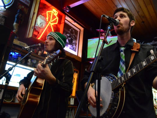 Guitarist Tim Doyle, left and banjo player James Doyle play with the Sons of Wexford Irish folk band at the Miracle Pub in Toms River in 2016.