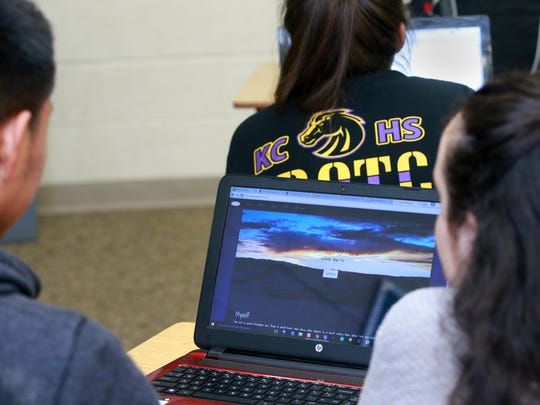 Students show off their work Thursday during an eight-week coding class led by the Albuquerque-based company Cultivating Coders at Shiprock High School.