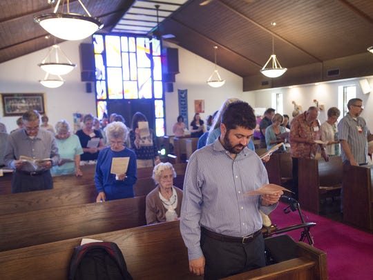 Members of the congregation recite a series of prayers