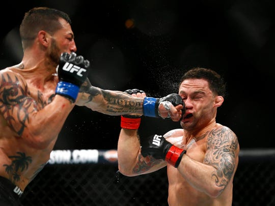 Frankie Edgar (red gloves) fights Cub Swanson (blue gloves) during UFC Fight Night at Atlantic City Boardwalk Hall. Mandatory Credit: Noah K. Murray-USA TODAY Sports