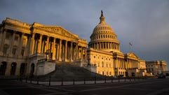 The U.S. Capitol building is lit by the rising sun