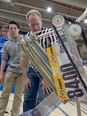 Iron County 4-H team Randomonium successfully hangs their robot in the Utah FTC Championships.
