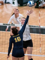 Michigan State's Brooke Kranda, right, challenges Michigan's Cori Crocker at the net during the first game of the match on Wednesday, Oct. 18, 2017, at the Jenison Field House in East Lansing.