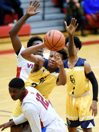 Eastern's  Diante Smith, center, is pressured by Everett's