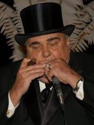Tom Cronin playing the harmonica at his own wedding