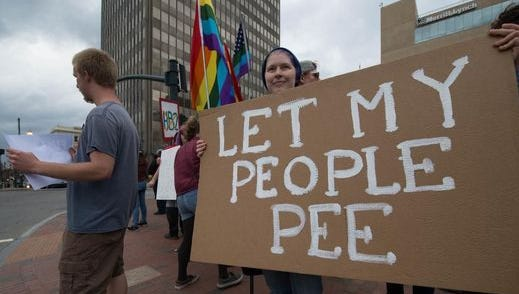 An anti-HB2 protester holds a sign at a March 24 demonstration in downtown Asheville.