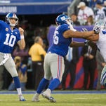 Dallas Cowboys defensive end Greg Hardy (76) and Sean Lee (50) celebrate after Hardy sacked New York Giants quarterback Eli Manning during the first half of Sunday's game.