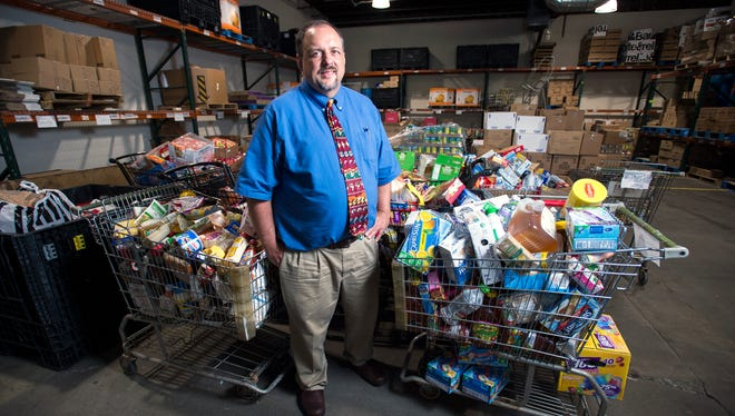 Joseph Sellepack, executive director of the Broome County Council of Churches, inside the Community Hunger Outreach Warehouse in Binghamton.
