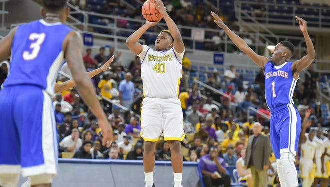 Eron Phillips shoots a three pointer as Westgate takes on AJ Ellender in the boys semi-final round of the state basketball championship in Burton Coliseum.  Thursday, March 9, 2017.