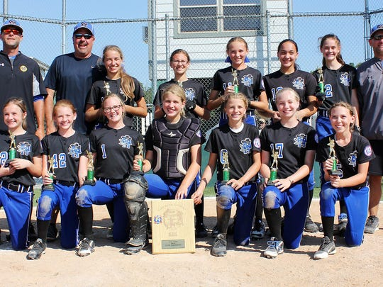 The Mountain Home Bandits 12-and-under team won the North Arkansas Babe Ruth softball state championship on Sunday at Keller Park. Team members are: first row, from left, Kaylee Jones, Anna McGraw, Tori Robb, Addison Yates, Marcie Cudworth, Gacie Uchtman, Emily Payne; second row, coach Shawn Loving, coach Brad Hasselwander, Reagan Hasselwander, Josie Kelly, Lauren Loving, Maleigha Morris, Kate Gilbert and coach Jimmy Yates.
