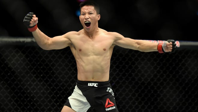 Ben Nguyen celebrates after defeating Ryan Benoit during their UFC 193 flyweight fight in Melbourne, Australia, Sunday, Nov. 15, 2015. (AP Photo/Andy Brownbill)