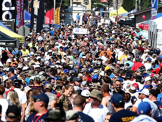 A view of race fans in the infield fan zone prior to