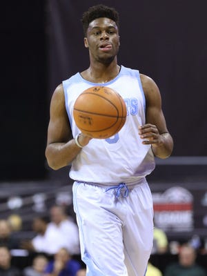 Denver Nuggets' Emmanuel Mudiay brings the ball up during the first half of an NBA summer league basketball game against the Atlanta Hawks Thursday, July 16, 2015, in Las Vegas.