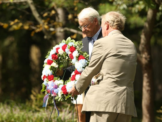 Harding Mayor Nicolas Platt, left, and Congressman Rodney Frelinghuysen place a memorial wreath at Memorial Park in New Vernon in 2016.