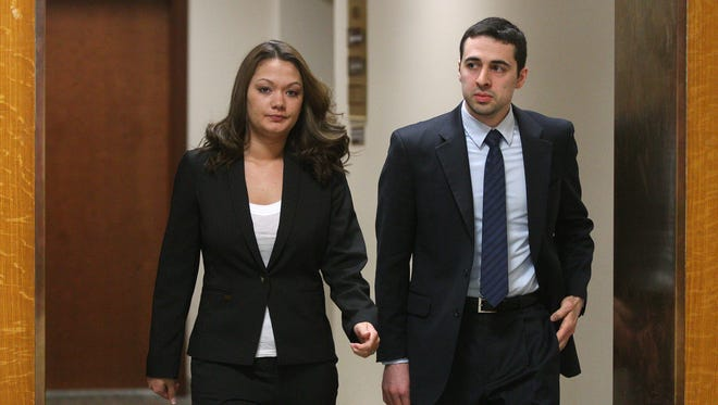 Dawn Nguyen and one of her attorneys Mark Foti make their way back into court after a break.  Nguyen is accused of buying guns for convicted felon William Spengler.
