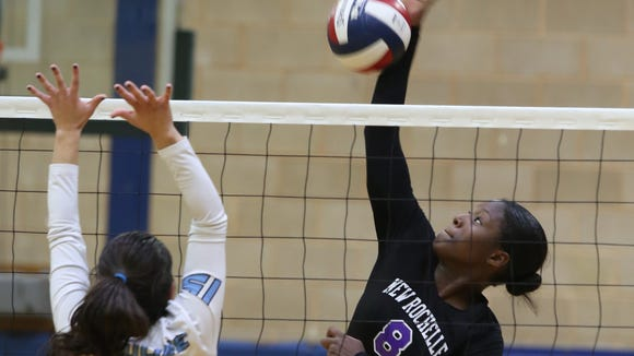 New Rochelle's Olivia Morgan (8) attacks a ball during Section 1 Class AA volleyball semifinals at Ursuline School in New Rochelle Nov. 2, 2016.  Ursuline defeats New Rochelle with a 25-19 fourth-set win.
