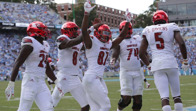 Louisville's Dez Fitzpatrick celebrates after scoring his second touchdown of the game against UNC. Sept. 9, 2017