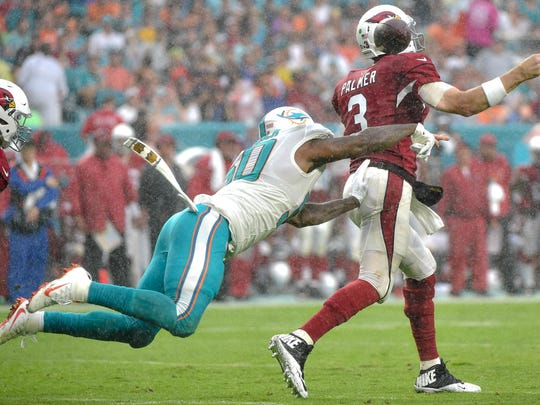 Miami Dolphins defensive end Andre Branch (50) causes Arizona Cardinals quarterback Carson Palmer (3) to fumble the ball during the second half at Hard Rock Stadium.