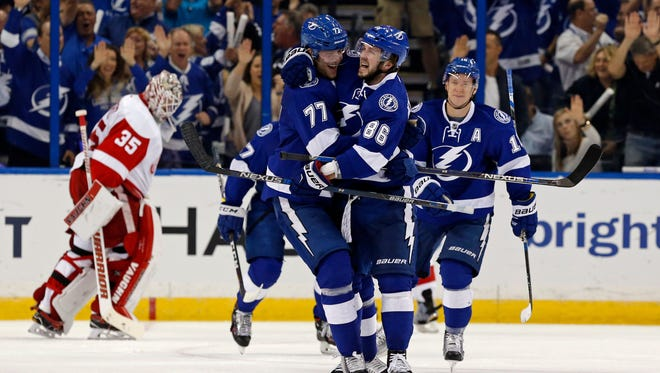 Nikita Kucherov (86) celebrates his goal with Victor Hedman during Tampa Bay's win in Game 2 Friday night.