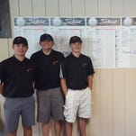 Marine City's boys golf team poses in front of the MAC Silver Championships scorecard at Maple Lane Golf Course on May 19, 2016.