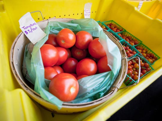 Tomatoes for sale at the La Semilla Food Center's Farm Fresh Mobile Market outside of Klein Park, Wednesday, August 24, 2016.