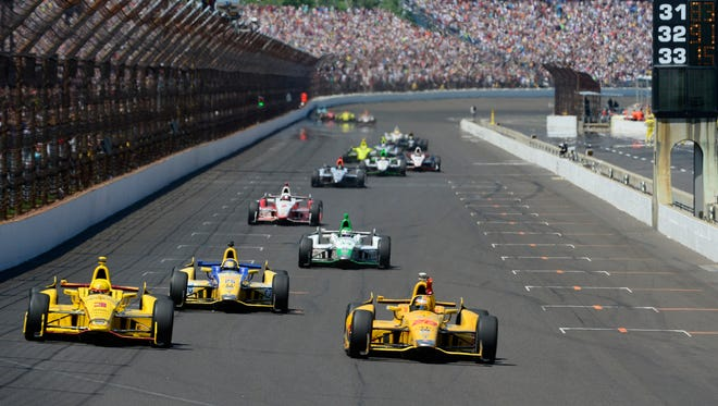 Ryan Hunter-Reay celebrates his victory of the 98th running of the Indianapolis 500 at the Indianapolis Motor Speedway, May 25, 2014