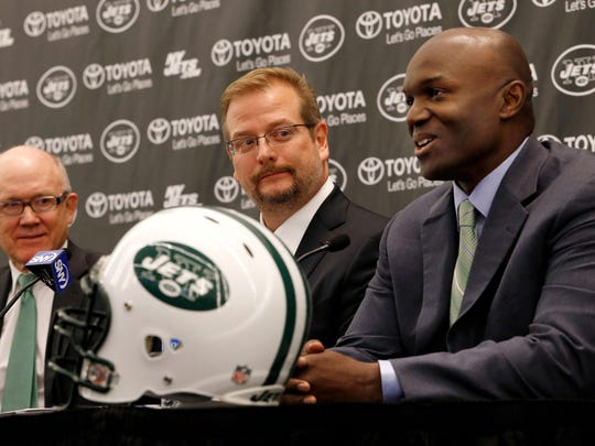 Jets coach Todd Bowles, right, earned a B this season for his team's performance while GM Mike Maccagnan, center, earned a B+.
