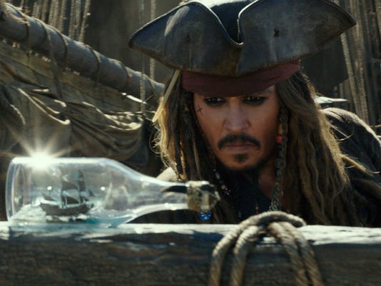 Online pirates claim to hold Disneyís latest ëPirates of the Caribbeaní movie hostage, demand ransom