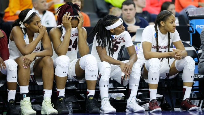 From left to right, South Carolina players Jatarie White, Sarah Imovbioh, Khadijah Sessions and Asia Dozier react on the bench during the second half of a regional semifinal women's college basketball game against Syracuse in the NCAA Tournament, Friday, March 25, 2016, in Sioux Falls, S.D.  (AP Photo/Charlie Neibergall)