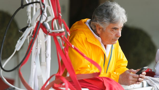 Gustavo Delgado, trainer of Kentucky Derby prospect Majesto, watched as his horse was bathed following a workout at Churchill Downs. April 29, 2016.