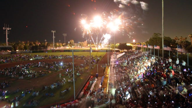 Spectators watch the 4th of July fireworks display at the Palm Springs Stadium.