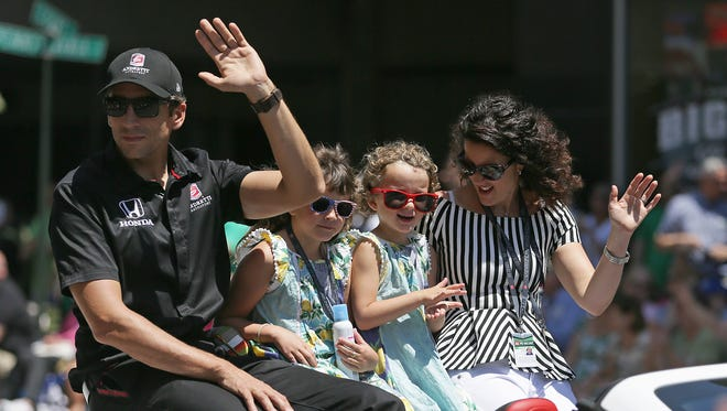 IndyCar driver Justin Wilson rode with his wife, Julia, and daughters in the  Indy 500 Festival Parade on May 23.