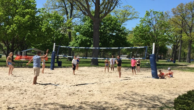 People play volleyball Wednesday at Lakeside Beach in Port Huron.