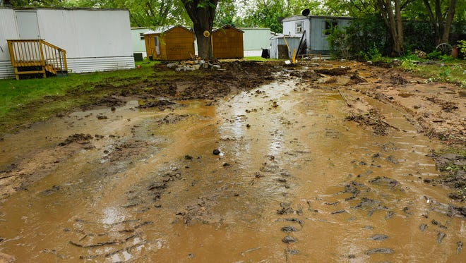 Mud and water remained after a mobile home over a broken water line was moved  Tuesday, June 26, at the Sartell Mobile Home Park.