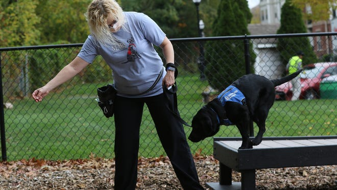 Kara Hubbard, of Newton, is seen training Hannah, a five-month-old NEADS Service Dog.