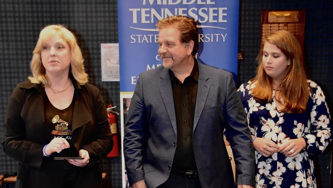 Beverly Keel, chair of MTSU's Department of Recording Industry, introduces the father of 2017 Grammy nominee and MTSU alumna Hillary Scott, Lang Scott, and Hillary's sister Rylee, at a reception in Los Angeles honoring the university's Grammy nominees.