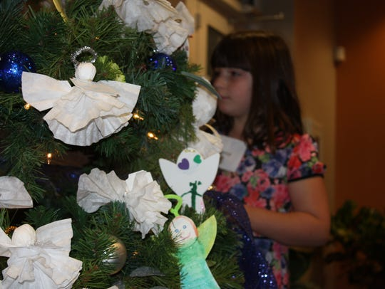 Each angel ornament signifies the life of a loved one