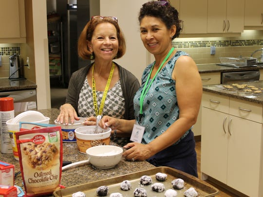 Mount Laurel's Rosanne Lemansky (left) helps out with another volunteer in the kitchen of Gift of Life's Family House in Philadelphia.