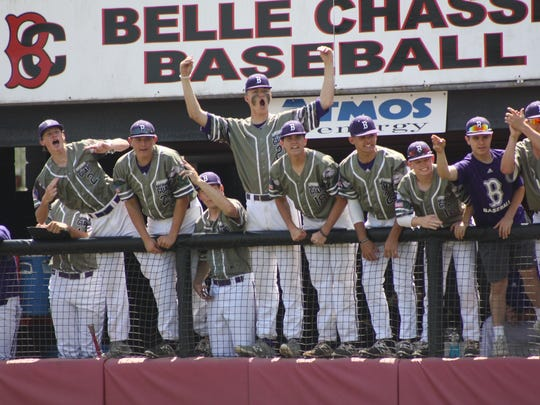 Benton's baseball team, with Turner Toms in the middle with arms raised, gets excited over a run.