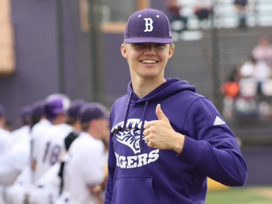 Benton's Turner Toms gives a thumbs up to the Tigers' performance in a game this season.