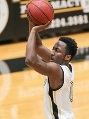 Anderson sophomore guard Randall Shaw shoots against