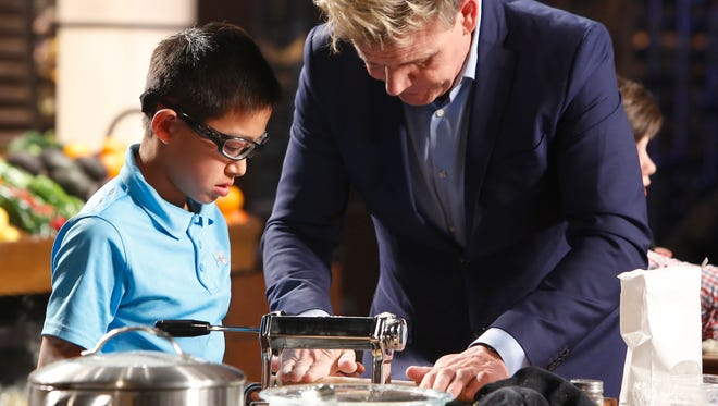 "Thousand Oaks resident Mashu Nishi, left, takes a few pointers from ""MasterChef Junior"" judge Gordon Ramsay while making egg-yolk ravioli during a recent episode of the show. The teen says the recipe is his signature dish."
