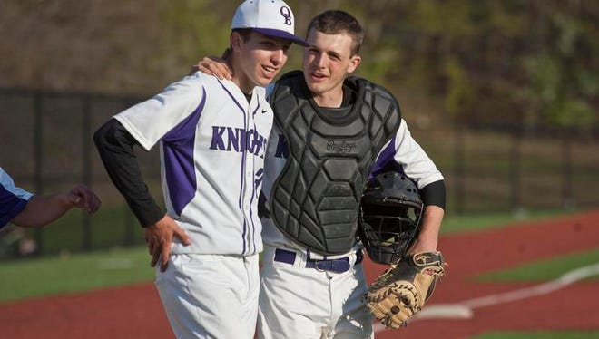 Old Bridge vs St. Joseph baseball game. Old Bridge's starting pitcher Zach Attianese gets a pat on the back from catcher Eugene Quirk after pitching a complete game shutout in Old Bridge, N.J., on Friday, May 2, 2014.