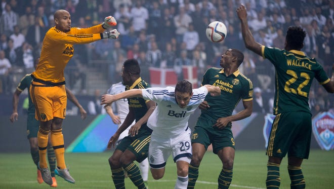 Portland Timbers goalkeeper Adam Larsen Kwarasey (12) stops a shot from the Vancouver Whitecaps FC during the first half of MLS soccer action in Vancouver, British Columbia, Canada, Sunday, Nov. 8, 2015.